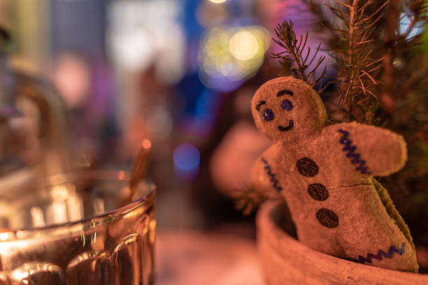 gingerbread man and a glass of glugg in denmark - christmas stock photos and pictures