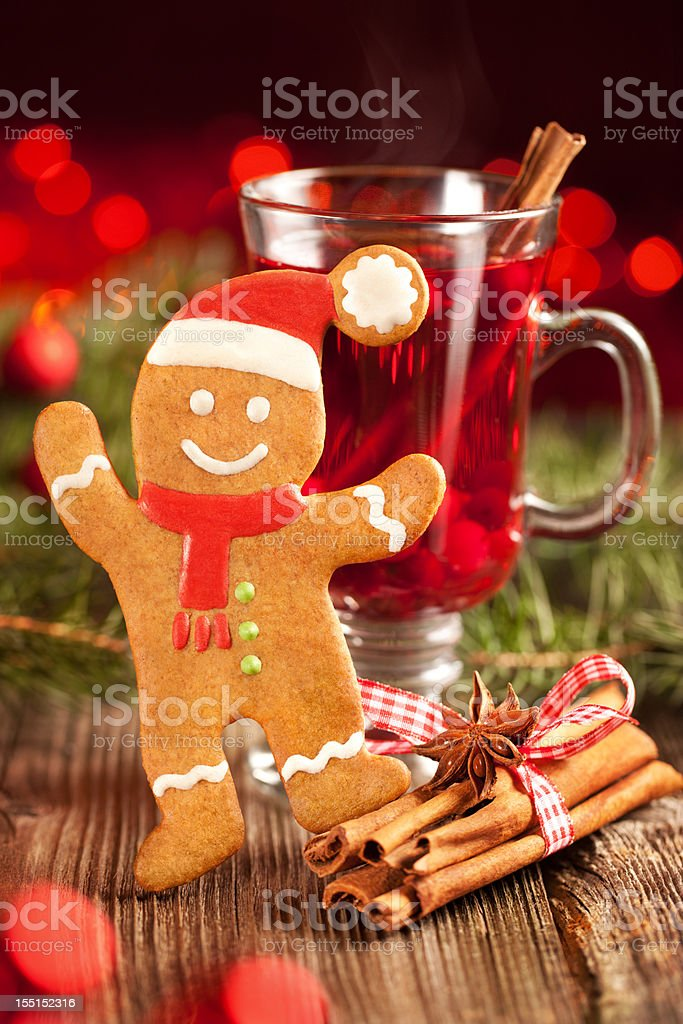 Gingerbread man and glass of mulled wine royalty-free stock photo