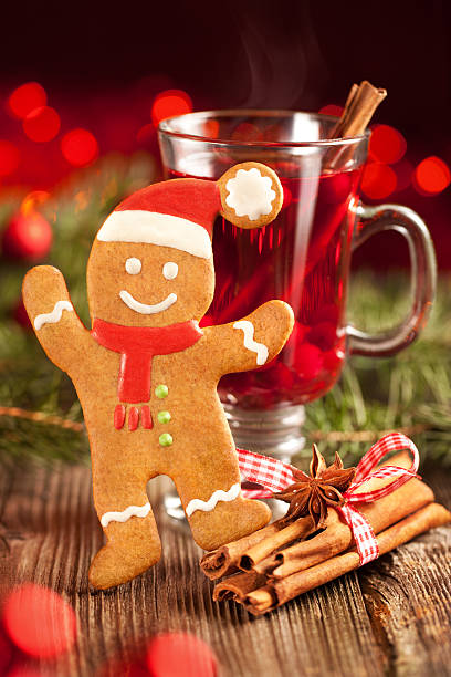 Gingerbread man and glass of mulled wine stock photo
