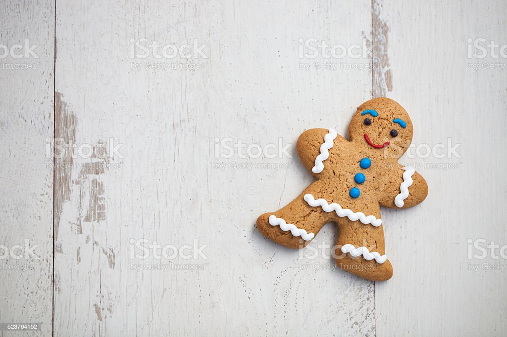 Gingerbread man cookie on wooden table stock photo