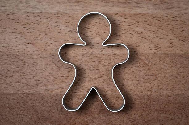 homme de pain d'épice de moulage anneau en forme - moules photos et images de collection