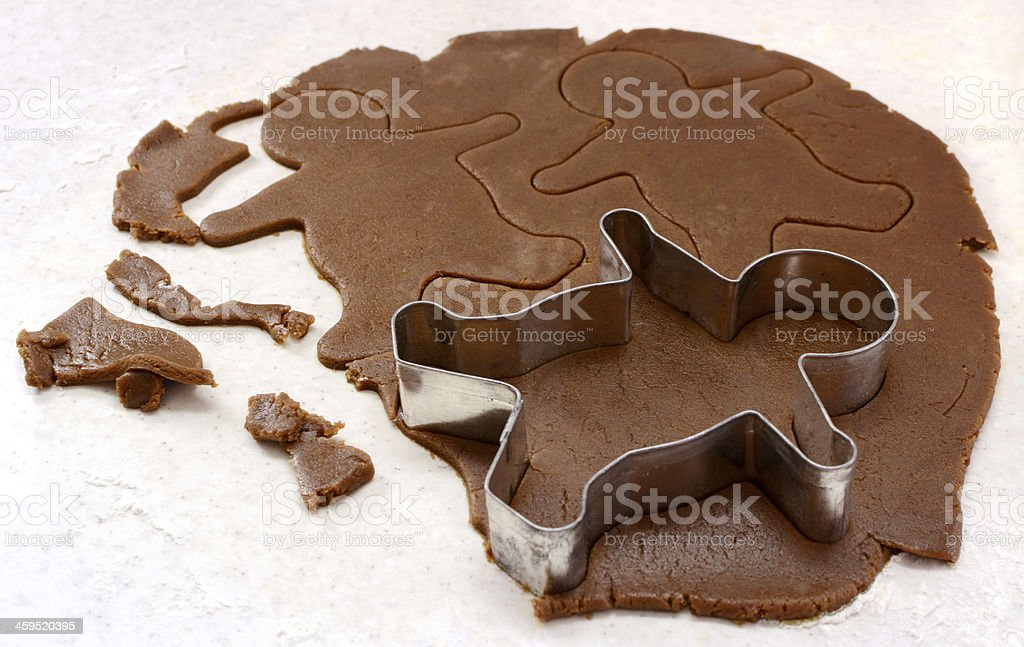 Gingerbread man shapes in cookie dough stock photo