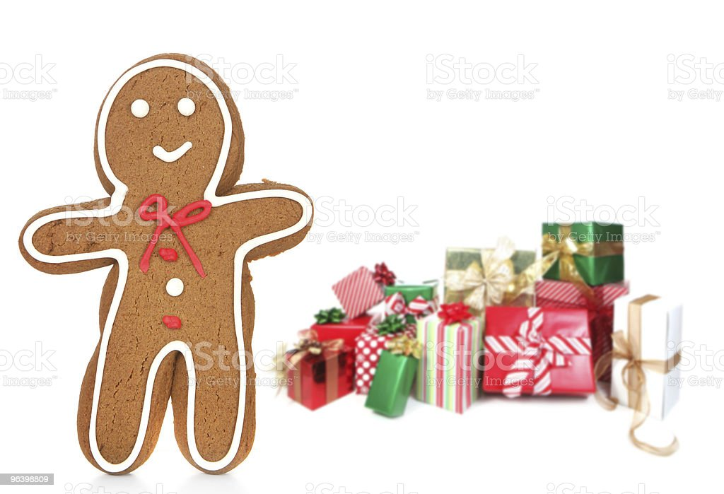 Gingerbread Man With Gifts in the Background - Royalty-free Celebration Stock Photo
