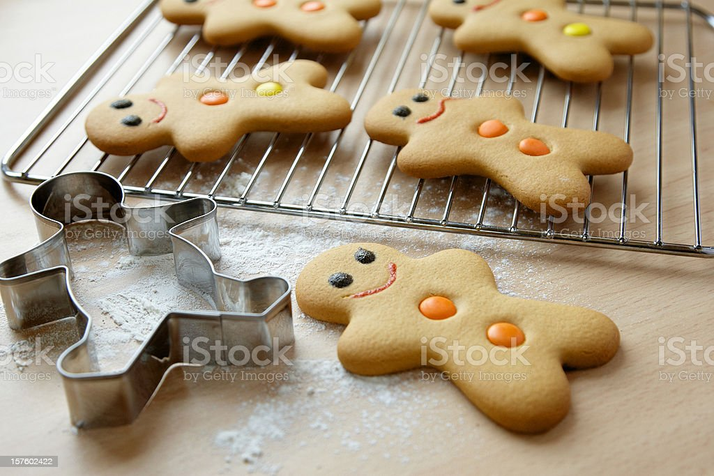Gingerbread men and cookie cutter stock photo