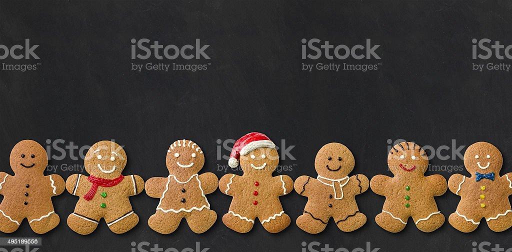 Gingerbread men on a blackboard stock photo
