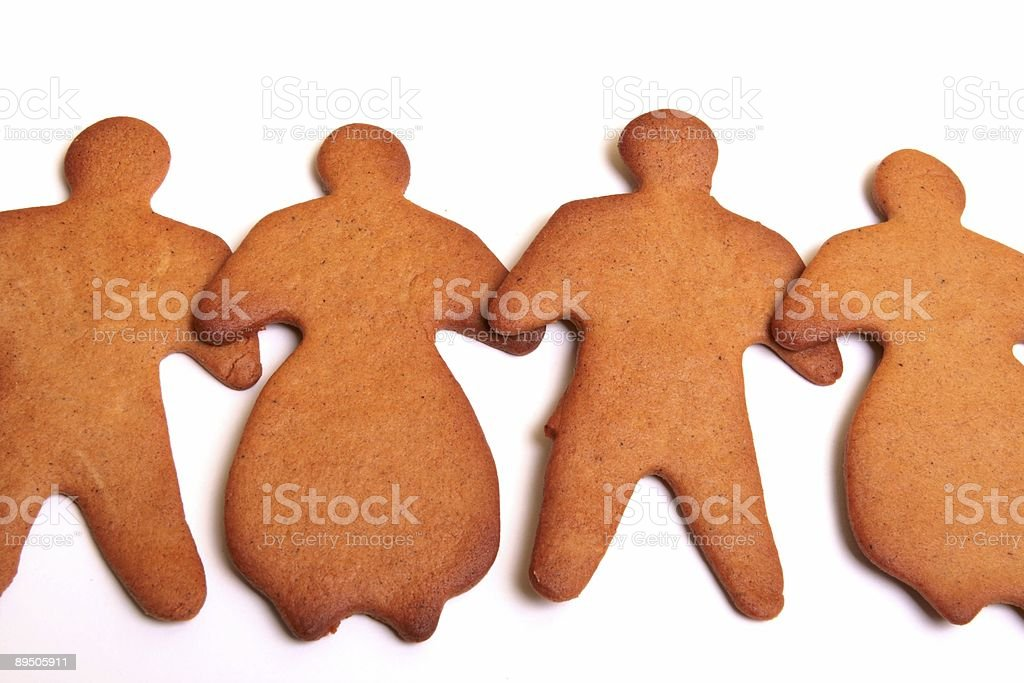 Gingerbread team - men and women royalty-free stock photo