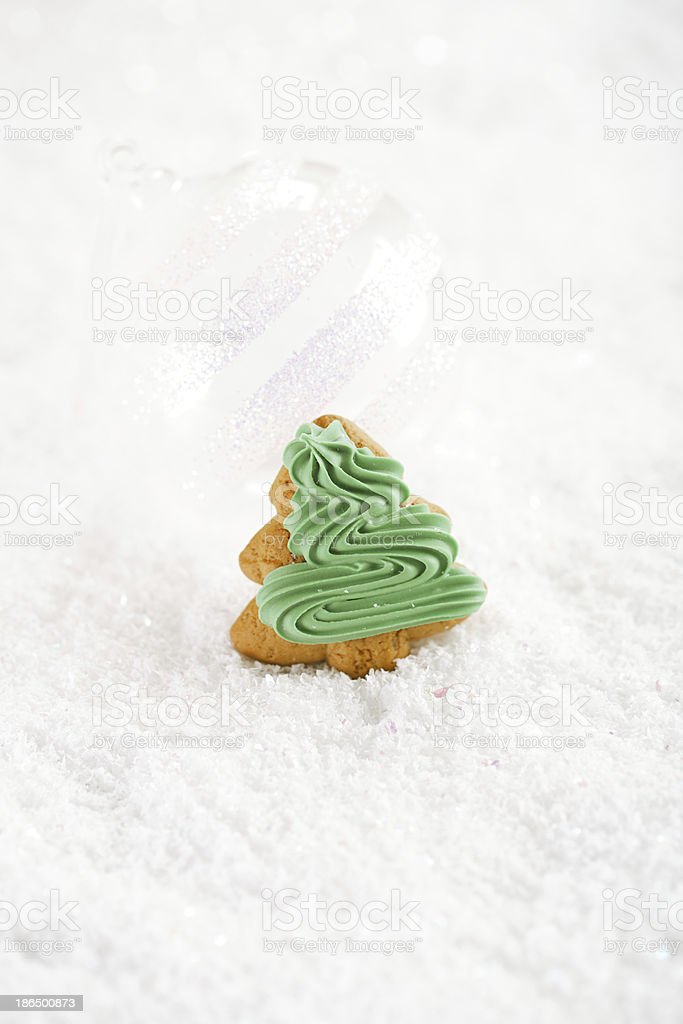 Gingerbread tree on a festive Christmas snow background, nice po royalty-free stock photo