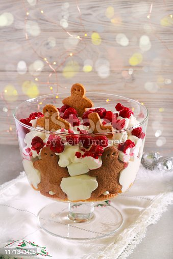 Gingerbread trifle - layered dessert with cream, fruit and gingerbread biscuits