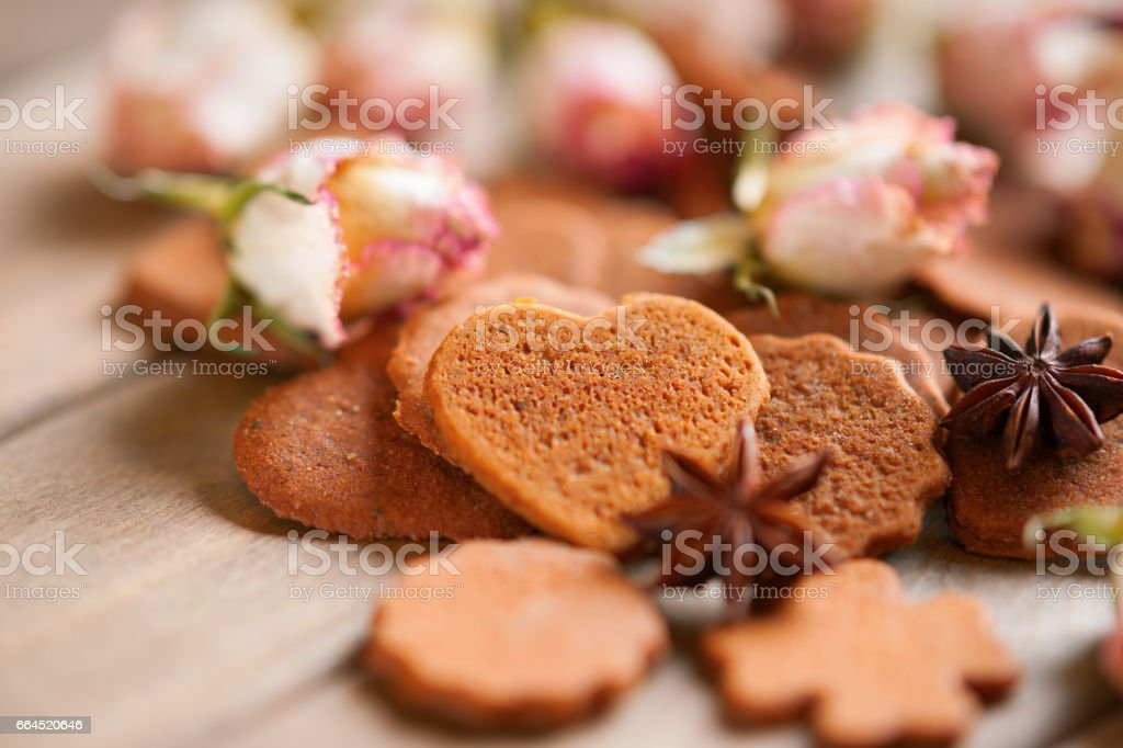 Gingerbreads and roses buds royalty-free stock photo