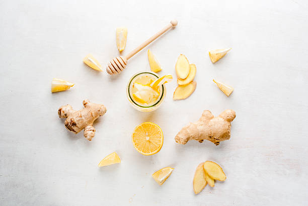ginger-lemon drink in a bottle with a straw - ginger stock photos and pictures