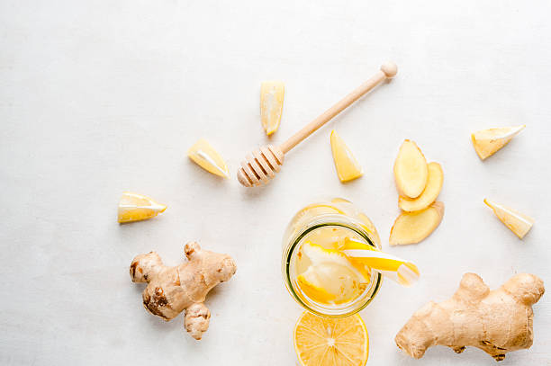Ginger-lemon drink in a bottle with a straw stock photo