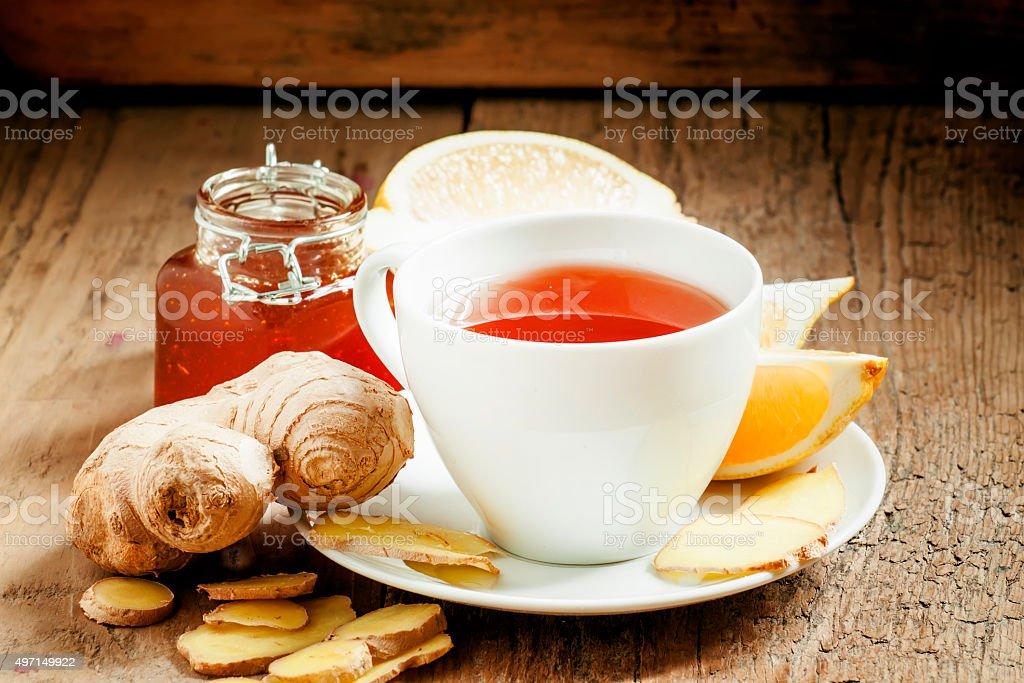 Ginger-lemon hot black tea with honey stock photo