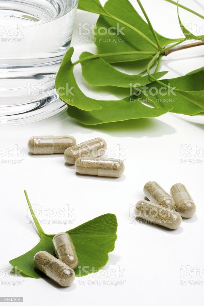 Ginkgo biloba capsules on ginkgo leaves royalty-free stock photo