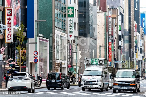 1188904934 istock photo Ginza district with modern business district and cars in traffic with Olympics 2020 sign 1146906611