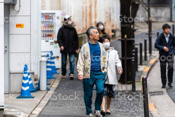 Ginza or akasaka district with people tourists senior couple walking picture id1146906496?b=1&k=6&m=1146906496&s=612x612&h=cd pabeo ecte2d8mbepn9j5hsrk1du4vjtm8llb9sq=