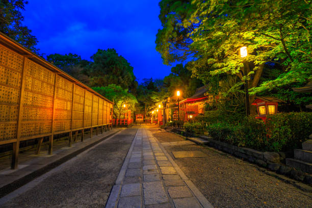 Gion Shrine at dusk Kyoto, Japan - April 25, 2017: Illuminated path at dusk from Yasaka Shrine to the Gion weeping cherry tree in Maruyama Park. Gion Shrine is one of the most famous shrines in Kyoto, Japan . shinto shrine stock pictures, royalty-free photos & images