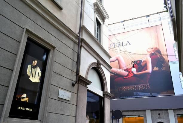 Giorgio Armani boutique window and giant publicity panels of Perla in the Montenapoleone street. stock photo