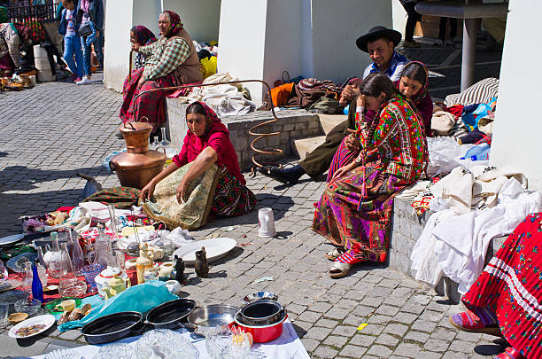 Gipsy selling they goods on the Small Square of Sibiu stock photo