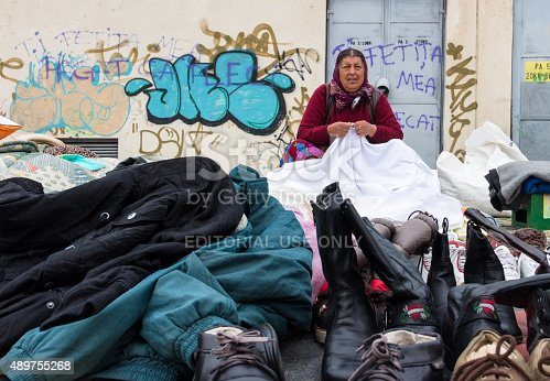 istock Gipsy woman selling clothes 489755268