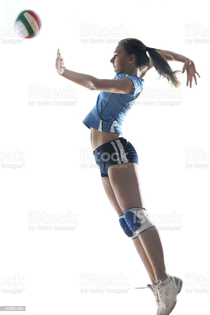gir playing volleyball stock photo