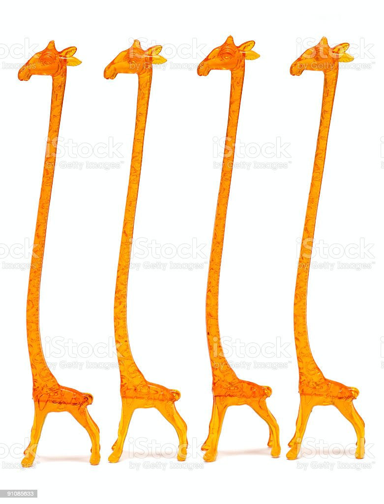 giraffe shaped cocktail stirrers royalty-free stock photo