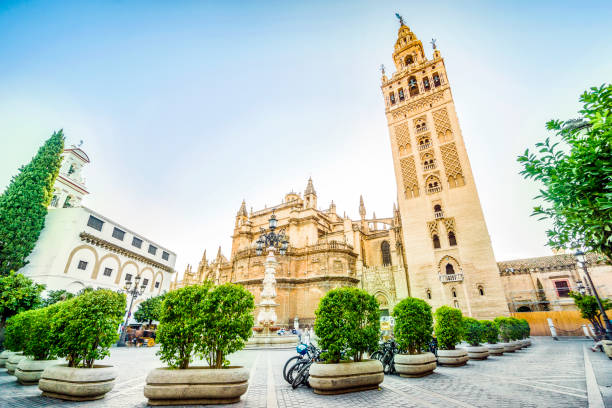 Giralda in Cathedral of Saint Mary, Seville, Spain Giralda Tower in Cathedral of Saint Mary of the See, Seville, Spain santa cruz seville stock pictures, royalty-free photos & images