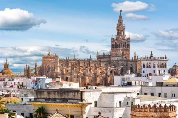 Giralda tower and Seville Cathedral, Spain Giralda tower and Seville Cathedral, Spain santa cruz seville stock pictures, royalty-free photos & images