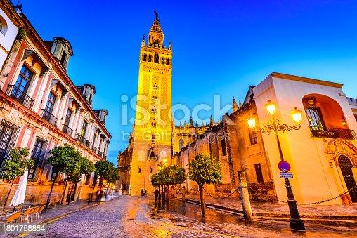Seville, Andalusia, Spain. Cityscape twilight image with Santa Maria de la Sede Cathedral and Girdala