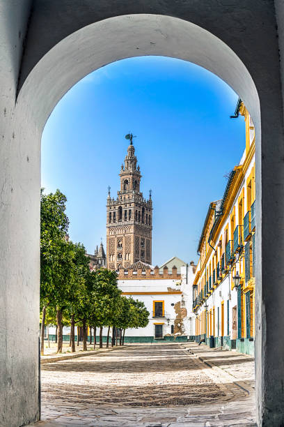 Giralda Tower in Seville Giralda Tower is a famous landmark in the city of Seville, Spain alcazar palace stock pictures, royalty-free photos & images