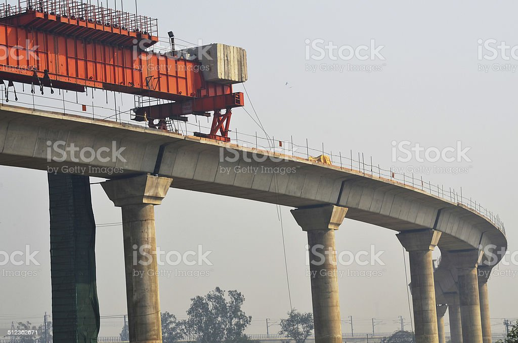 Girder at construction site of elevated rail track stock photo