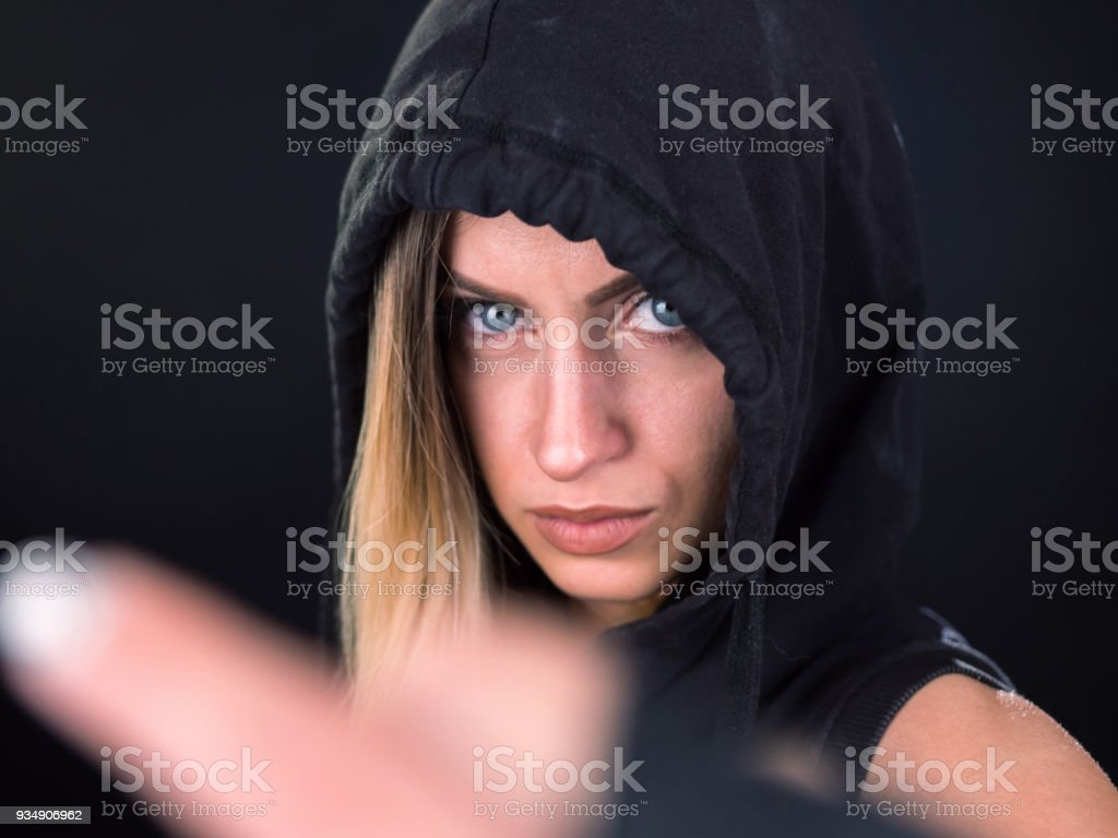 Girl a young rebel gesturing to camera stock photo
