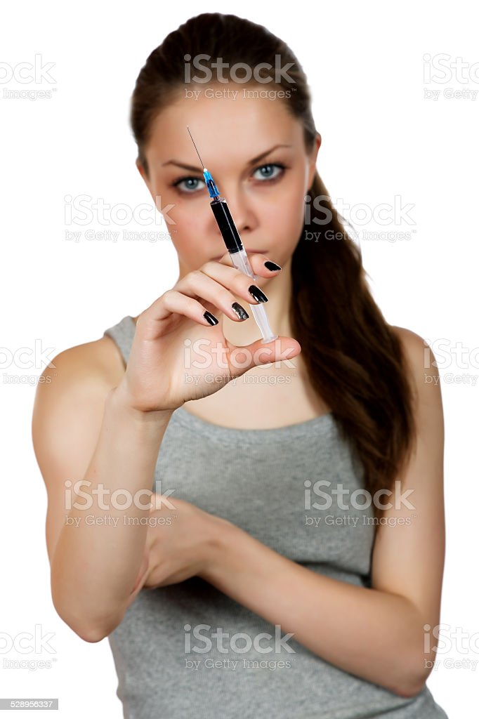girl about a syringe in  hand on  white background stock photo