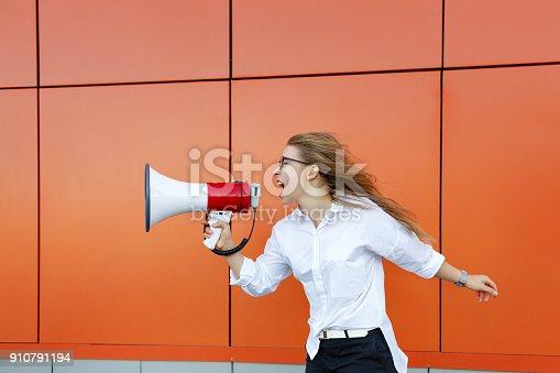 istock Girl activist yelling at loudspeaker 910791194
