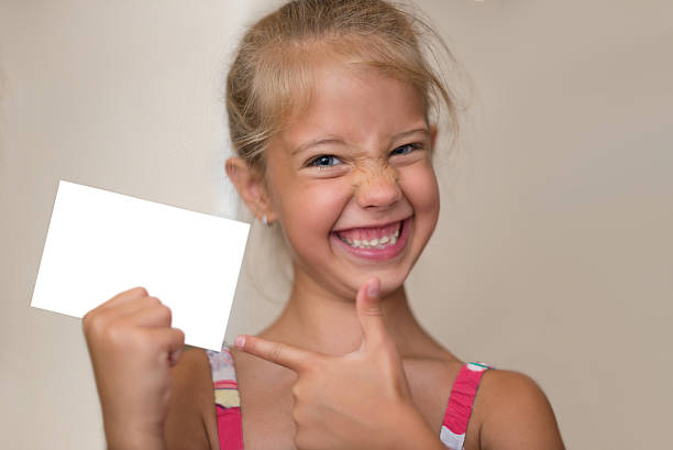 girl advertising - gift voucher or card stock photos and pictures