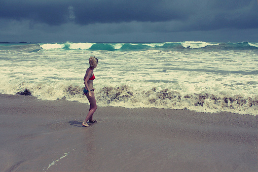girl afraid of stormy ocean, Galapagos