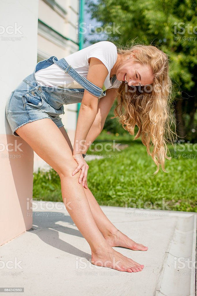 girl against a wall and fooled laugh stock photo