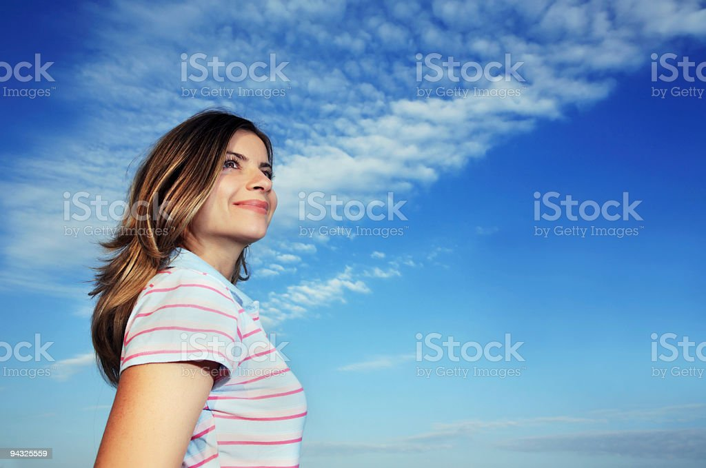 Girl against blue sky royalty-free stock photo