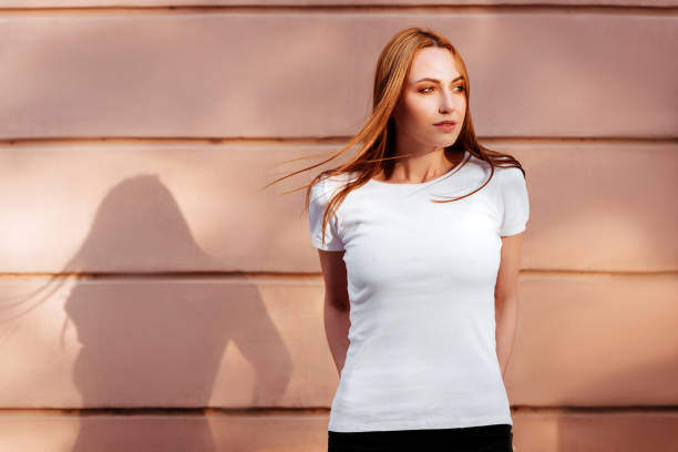 Girl against street wall, minimalist style. stock photo