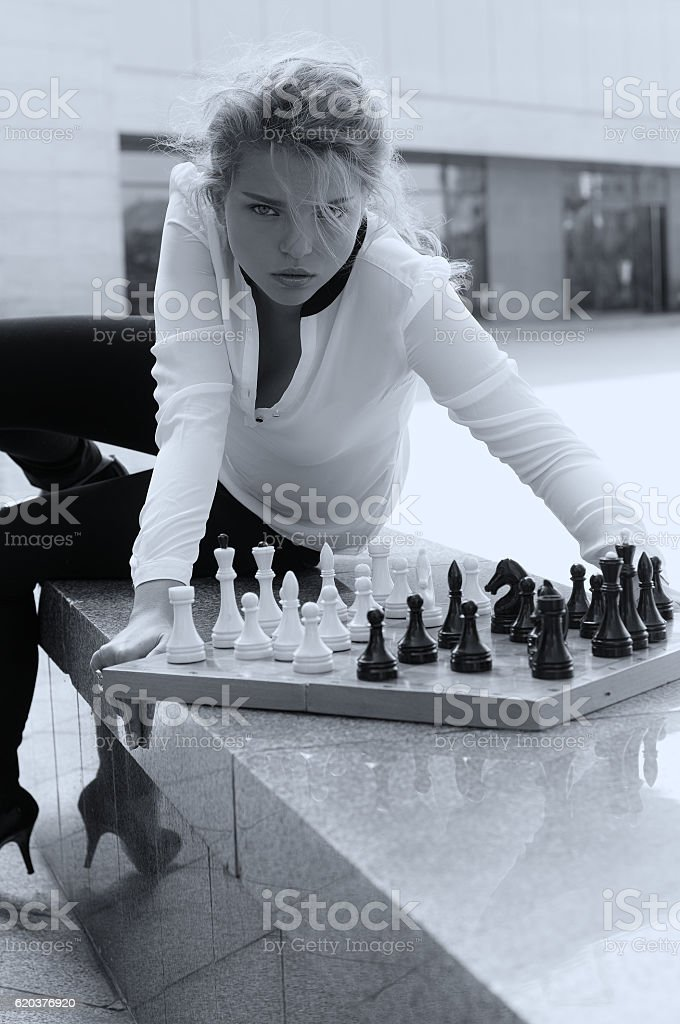 Girl aggressively playing chess foto de stock royalty-free