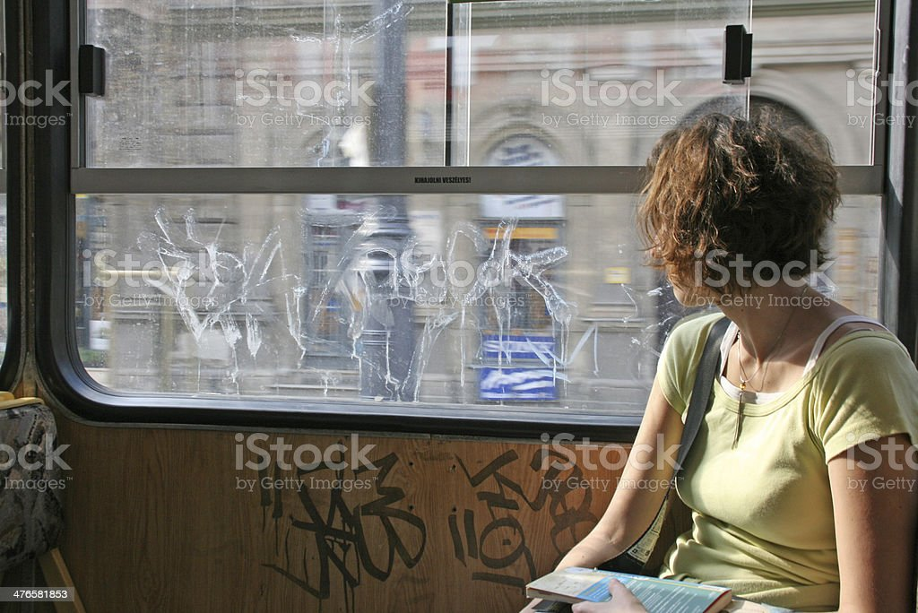 Girl alone in a tramway, Budapest, Hungary. royalty-free stock photo