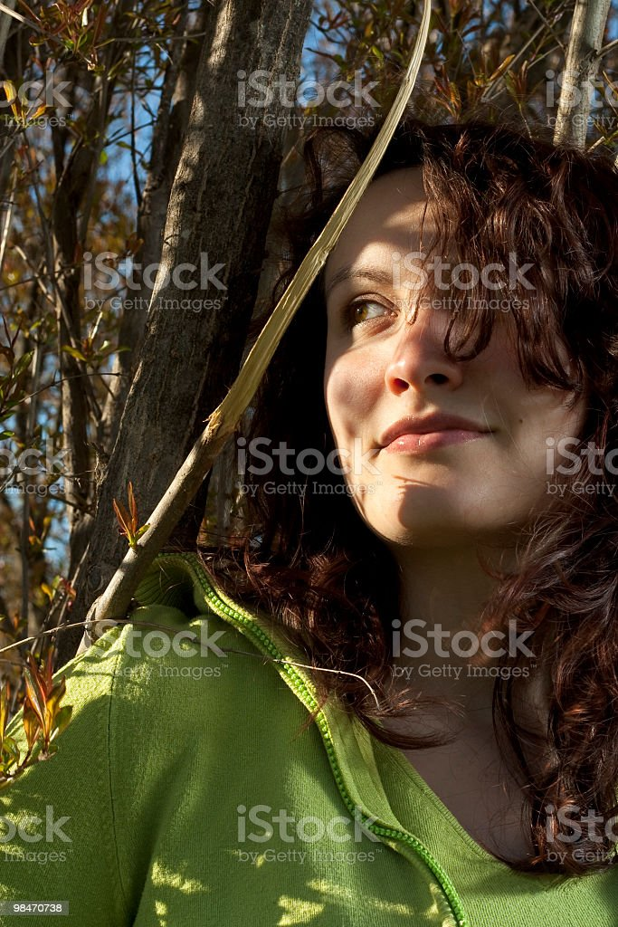 Girl among Branches royalty-free stock photo