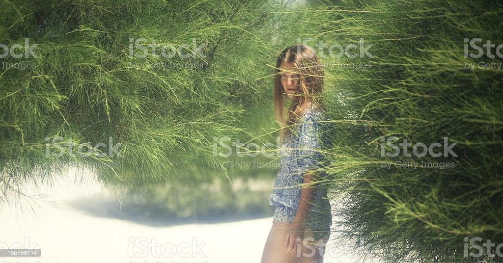 Girl among the trees royalty-free stock photo