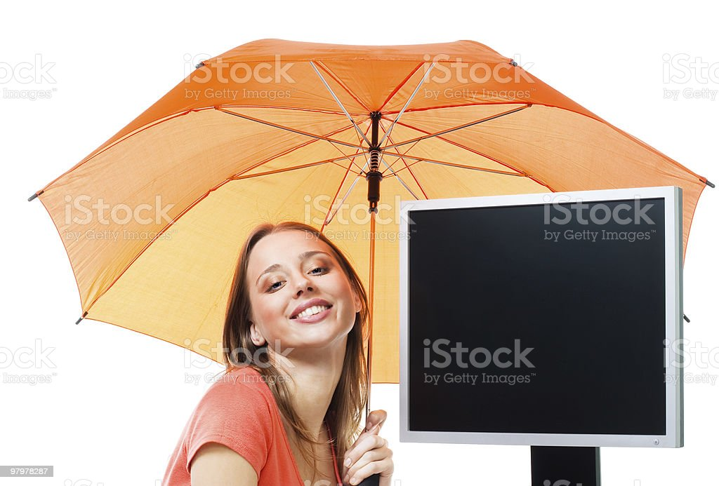 Girl an computer under umbrella royalty-free stock photo