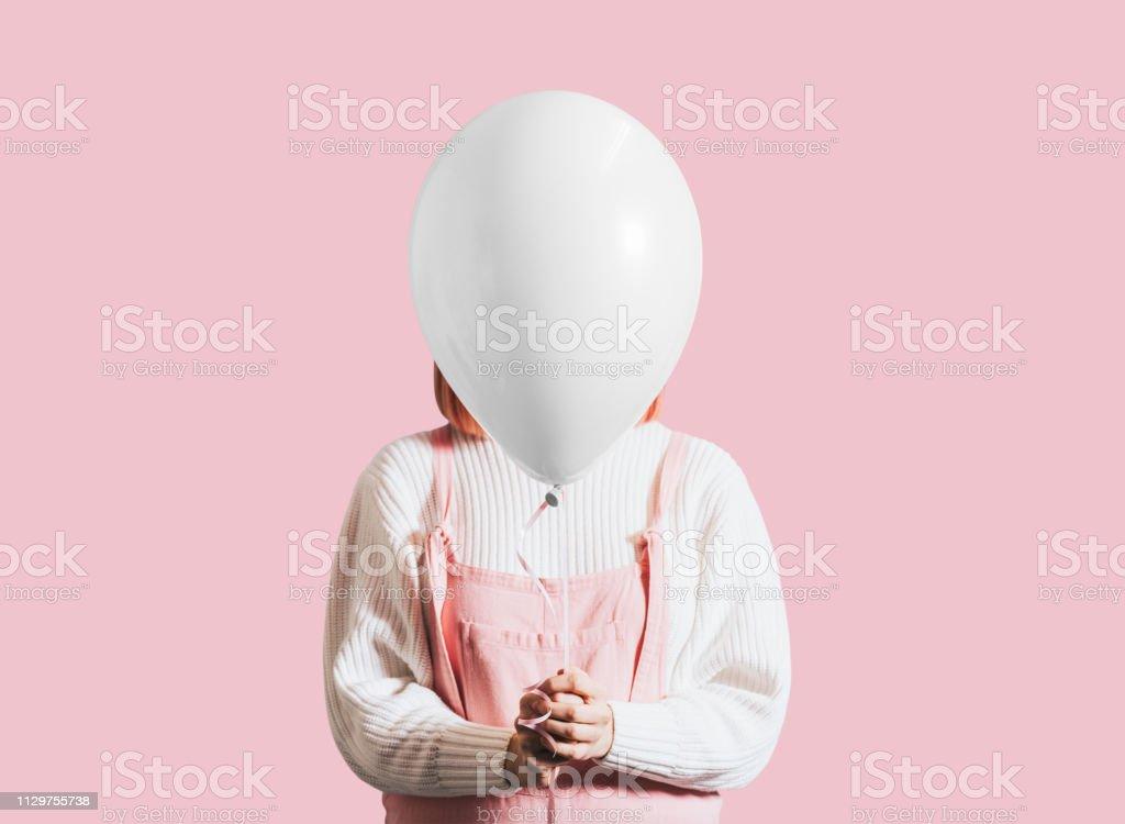 Girl and a ballon stock photo