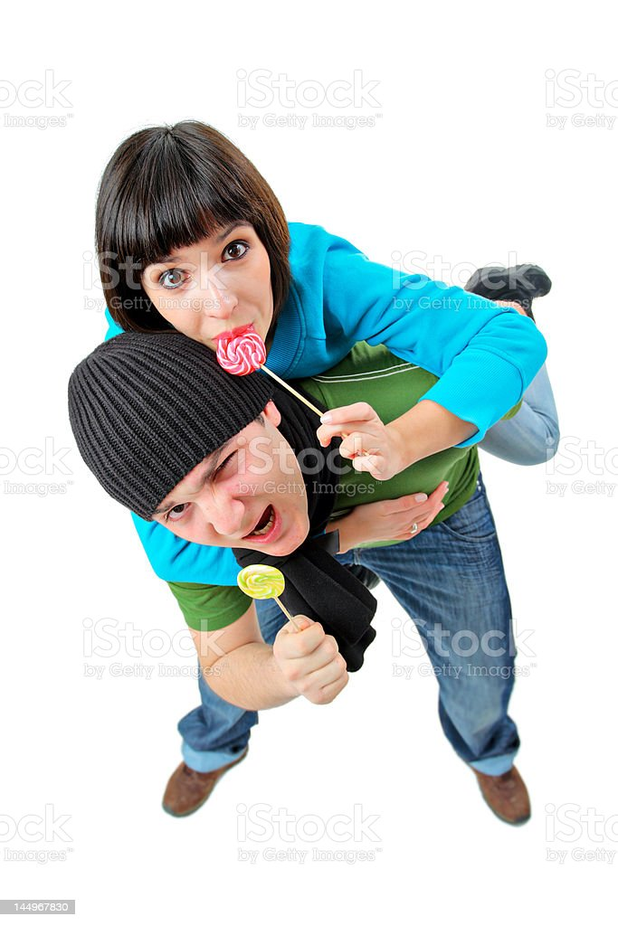 Girl and a boy with lollipops royalty-free stock photo