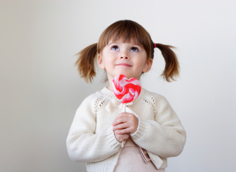 istock Girl and a lollipop 95843538
