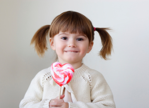 istock Girl and a lollipop 96311736