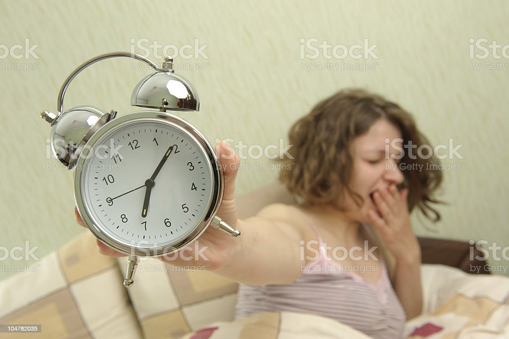 Girl and alarm clock royalty-free stock photo