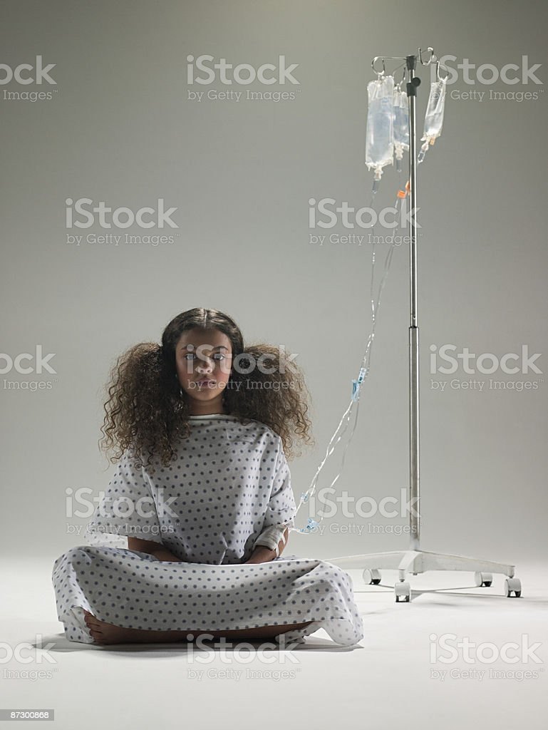 Girl and an intrevenous drip royalty-free stock photo