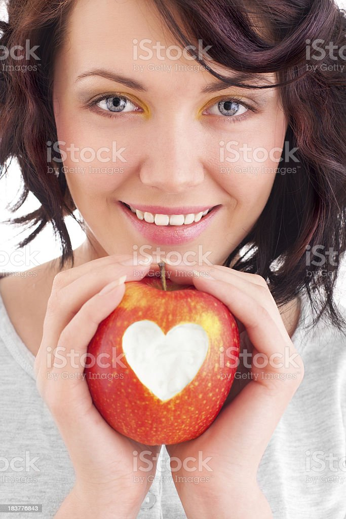 Girl and apple stock photo